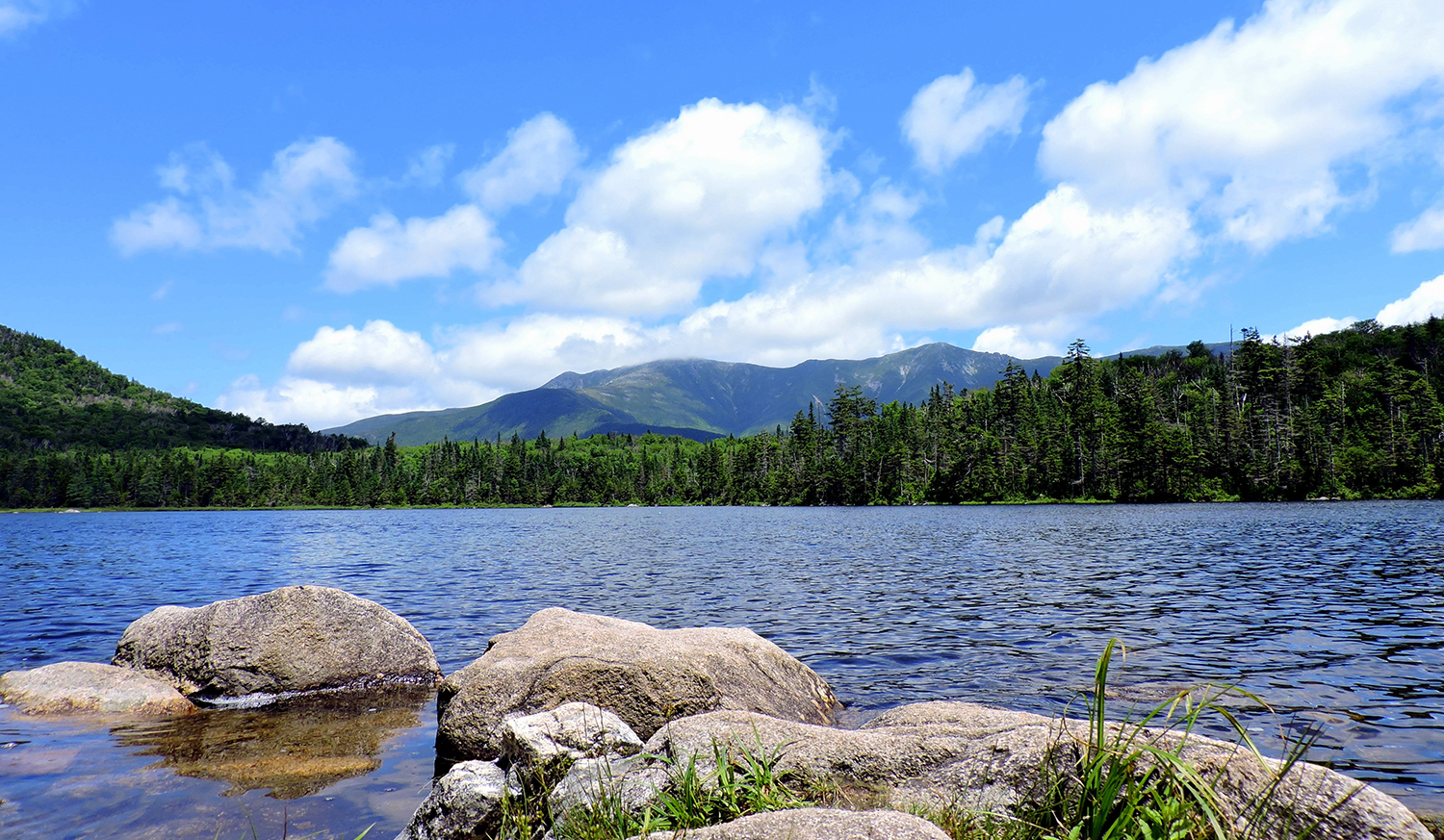 Scenic shot of NH lake with mountains in background